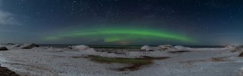 actual photo of the northern lights taken from the beach